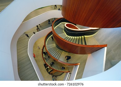 SYDNEY, AUSTRALIA -7 AUG 2017- View of the landmark walnut wood spiral staircase in the Abercrombie Building at the University of Sydney Business School.
