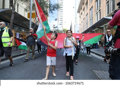 Sydney Australia 8 April 2018 — Protest for Palestine at Town Hall, Sydney CBD. Two children hold flags