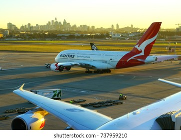 SYDNEY, AUSTRALIA -9 AUG 2017- An airplane from Qantas Airways (QF) at the Kingsford Smith airport (SYD), with the Sydney skyline in the background.