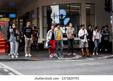 Sydney, Australia - April 1, 2019: People waiting to cross the road at Liverpool street, Sydney CBD.
