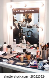 SYDNEY AUSTRALIA - APRIL 14 2015: Makeup working place during Lee Matthews fashion show backstage at Mercedes Benz Fashion Week in Carriageworks Sydney Australia.