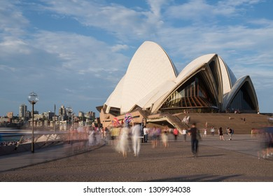 Sydney, Australia - April 2, 2017: Visitors and tourists to Sydney's iconic opera house are blurred in a long exposure.