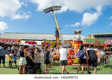 Sydney, Australia - April 20, 2019: Crowd of people in front of attraction rides at Sydney Family Easter Show.