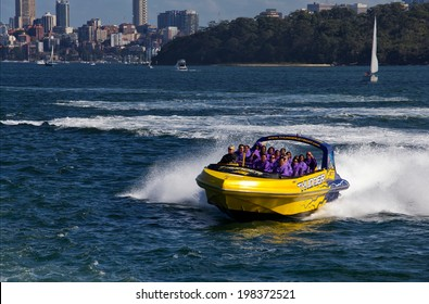 SYDNEY, AUSTRALIA - APRIL 20,2014: Tourists enjoy a jet boat ride on the harbour. Several companies operate jet boats in Sydney, offering rides in the harbour and the open ocean.