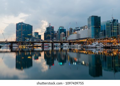 Sydney, Australia - April 21, 2018: Sydney skyline from Darling Harbour with reflection on the calm water at dawn.