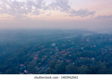 Sydney, Australia - April 22 2019: Rural Fire Services (RFS) Hazard reduction burns create smoke and haze over Sydney basin, reducing visibility and increasing risk of asthma and respiratory problems