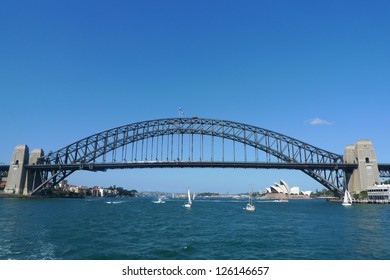 SYDNEY, AUSTRALIA - APRIL 3: The famous Harbour bridge and Opera House in Sydney on April 3, 2011 in Sydney, Australia.  Until 1967 the Harbour Bridge was Sydney's tallest structure.