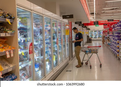 SYDNEY, AUSTRALIA - APRIL 7TH, 2018 - A man surveying frozen food at Coles Supermarket.
