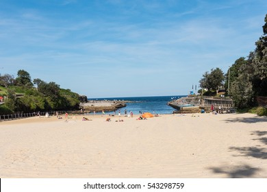 Sydney, Australia - April 9, 2016: Clovelly Beach along the Bondi to Coogee coastal walk.  A cliff top coastal walk featuring stunning views, beaches, parks, cliffs, bays and rock pools.