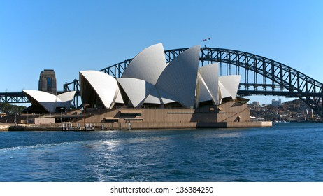 SYDNEY, AUSTRALIA - AUGUST 01 : Sydney Opera House and city centre. 01 August 2009 in Sydney, Australia. A famous tourist attraction and popular landmark with bridge in background