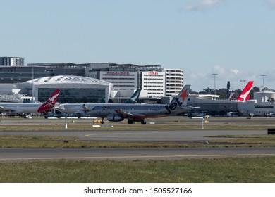 Sydney, Australia - August 10, 2019: Jetstar Airbus A320 at Sydney International Airport runway. Registration: VH-VQR