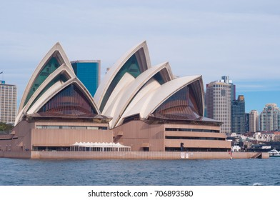 Sydney, Australia - August 12, 2017: Sydney Opera house close up with office buildings of Sydney Central Business District on the background. Circular Quay, Sydney Harbour