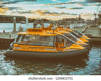 SYDNEY, AUSTRALIA - AUGUST 19, 2018: Water taxis docked in Darling arbour. They are a common way to move across the city.