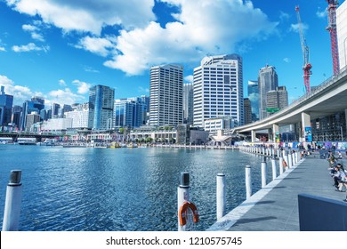 SYDNEY, AUSTRALIA - AUGUST 19, 2018: City skyscrapers in Darling Harbour on a beautiful sunny day. Sydney attracts 15 million tourists annually.