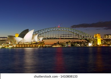 SYDNEY, AUSTRALIA - AUGUST 2016: panoramic view of Harbor bridge and Opera house, two of the landmarks of Sidney, at dusk