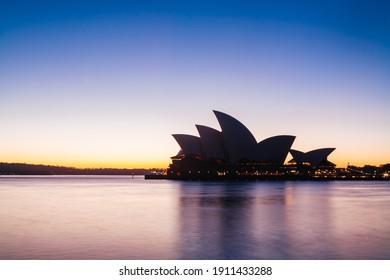 Sydney, Australia - August 21 2009: Sydney Opera House is silhouetted against a brilliant winter sunrise
