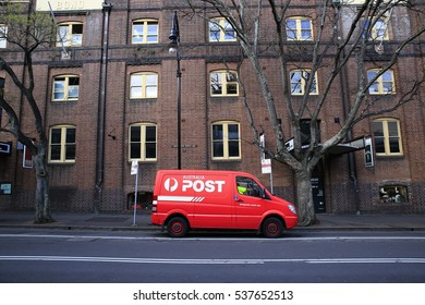 Sydney, Australia - August 25, 2015: A delivery van from Australia Post is parked outside an historic building in the Rocks district, one of Sydney top tourist precinct and historic area.