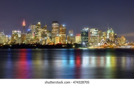 SYDNEY AUSTRALIA - August 27,2016: View Sydney CBD and The Opera House on sunset, Sydney, Australia, Over 10 millions tourists visit Sydney every year