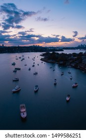 Sydney, Australia - August 4, 2019: Boats on the Parramatta River with Sydney skyline on the background.