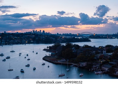 Sydney, Australia - August 4, 2019: Cloudy sunrise view of Sydney skyline from Parramatta River.