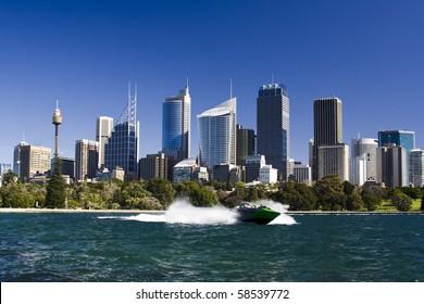 sydney australia city central business district view from royal botanic garden over bay blue skyline jet boat