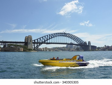 Sydney, Australia - Dec 22, 2014. Speedboat running nearby Sydney Harbour Bridge, over the harbour of Sydney, New South Wales, Australia.