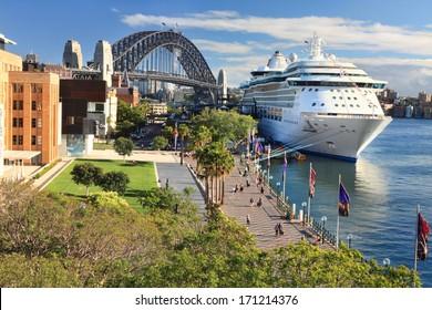 SYDNEY, AUSTRALIA - DECEMBER 1, 2013;  Luxury Cruise liner, Radiance of the Seas, docked at Circular Quay and passengers disembark.