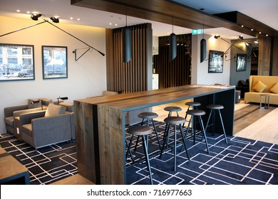 SYDNEY, AUSTRALIA – DECEMBER 16 2014: American Express Company opens its first Australian airport lounge at Sydney Airport's international terminal. Travellers can relax in a variety of spaces.
