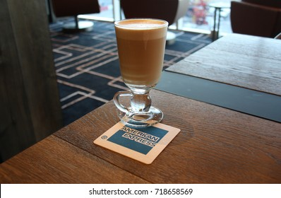 SYDNEY, AUSTRALIA – DECEMBER 16 2014: American Express Company opens its first Australian airport lounge at Sydney Airport's international terminal. Coffee is served to guests on AMEX-brand coasters.