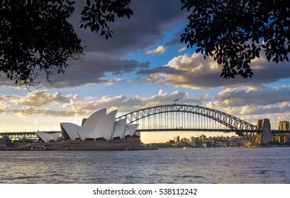 SYDNEY AUSTRALIA - December 17, 2016: View Sydney CBD and The Opera House on sunset, Sydney, Australia, Over 10 millions tourists visit Sydney every year