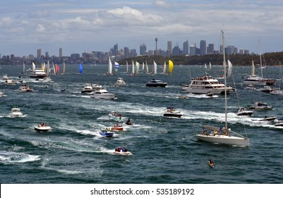 Sydney, Australia - December 26, 2012. Participants yachts in Sydney Harbour after the start. Sydney to Hobart Yacht Race is an annual event, starting in Sydney on Boxing Day and finishing in Hobart.
