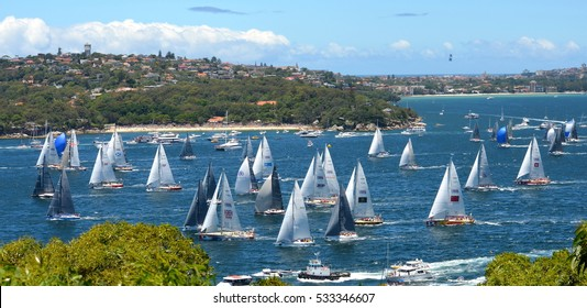 Sydney, Australia - December 26, 2013. Participants yachts in Sydney Harbour after the start. Sydney to Hobart Yacht Race is an annual event, starting in Sydney on Boxing Day and finishing in Hobart.