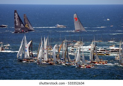 Sydney, Australia - December 26, 2013. While Wild Oats already on open water, last yachts just turning to Tasman Sea. Sydney to Hobart Yacht Race on Boxing day.