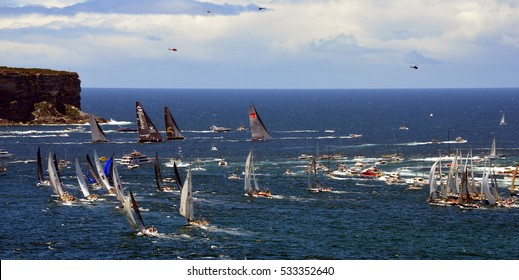 Sydney, Australia - December 26, 2013. Leader yacht Wild Oats and other Participant Yachts approaching Tasman Sea. Sydney to Hobart Yacht Race on Boxing day.