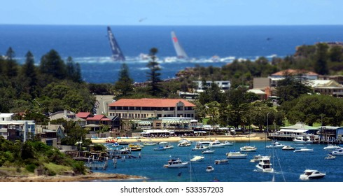 Sydney, Australia - December 26, 2013. Watson Bay at Christmas on Boxing day. Wild Oats and Perpetual 8 yachts in the background. Sydney to Hobart Yacht Race.