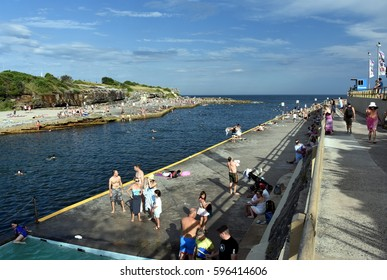 Sydney, Australia - Feb 5, 2017. People relaxing, swimming and sun bathing on Clovelly beach. Clovelly Beach is a small and tranquil beach, popular with families and snorkellers.