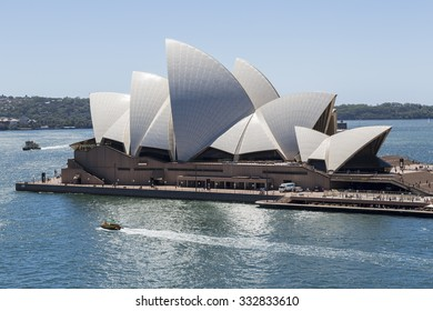 SYDNEY, AUSTRALIA - FEBRUARY 03, 2014: Sydney ferries pass Opera House, The Opera House opened in October 1973 and was designed by Jorn Utzon.