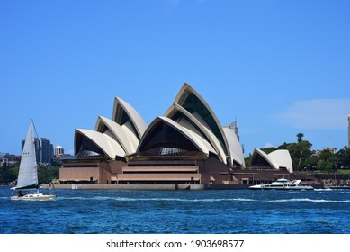 Sydney, Australia - February 11, 2020: View of the iconic Sydney Opera House with sail boat in sunny day