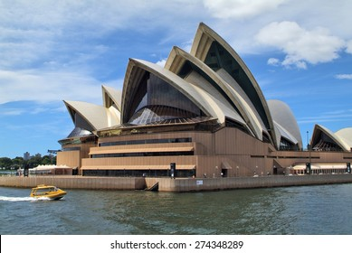SYDNEY, AUSTRALIA - FEBRUARY 11 : Sydney Opera building on Circular quay, landmark and preferred tourist attraction, and typical water taxi, on February 11, 2008 in Sydney, Australia