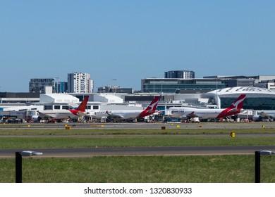 Sydney, Australia - February 12, 2019: Qantas Boeing 747 and Qantas A330 parking at Sydney Airport.