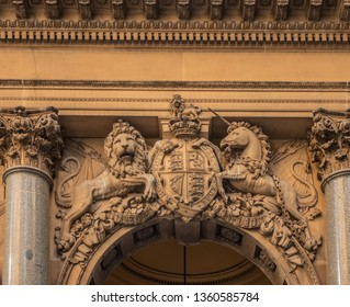 Sydney, Australia - February 12, 2019: Historic and Iconic General Post Office building facade on corner of Martin Place and , George Street. British Coat of Arms with lion and unicorn  above spandrel