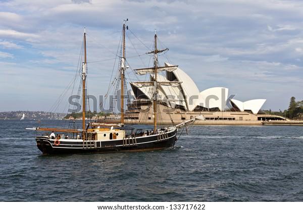 SYDNEY, AUSTRALIA - FEBRUARY 19 : Sydney Clipper Ship sailing in front - Sydney Opera House. 19 February 2011 in Sydney, Australia. A famous tourist attraction and popular landmark