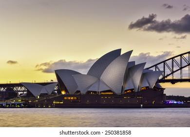 SYDNEY AUSTRALIA - February 6, 2015 : View of sunset at Sydney Opera House in Sydney, Australia.Over 10 millions tourists visit Sydney every year,making Sydney one of the world's tourist destinations.