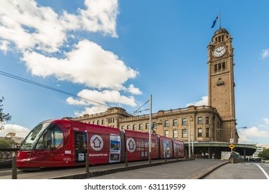 Sydney, Australia February 9 2017: A red light rail tram leaves Sydney Central Railway Station, Australia.  The new light rail network will have a 12km route with 19 stops.
