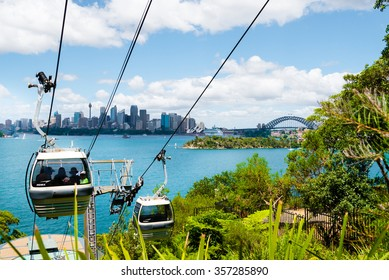 Sydney, Australia - January 11, 2014 : The Sky Safari cable car at Taronga Zoo in Sydney with Opera House and Harbour Bridge in background. Taronga Zoo is the city zoo of Sydney,  Australia