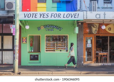 Sydney, Australia - January 11 2018:  A yes sign on a rainbow backdrop supporting gay marriage and the lgbt community in Newtown, a diverse, hipster, trendy, bohemian neighbourhood.