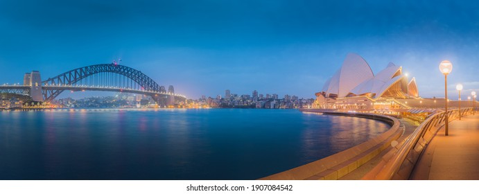 Sydney, Australia - January 12 2018: A wide Summer night panorama cityscape skyline view of the iconic Sydney Harbour and Sydney Harbour Bridge in NSW, Australia.