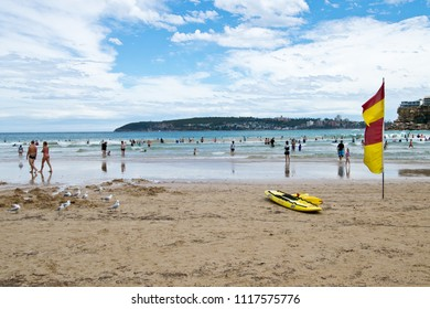 SYDNEY, AUSTRALIA - JANUARY 13, 2018: People enjoying a summer day on Freshwater Beach, a beautiful family patrolled sandy beach in Sydney