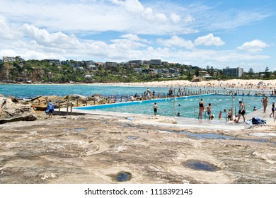 SYDNEY, AUSTRALIA - JANUARY 13, 2018: People enjoying a summer day at a rock pool on Freshwater Beach, a beautiful family beach in Sydney