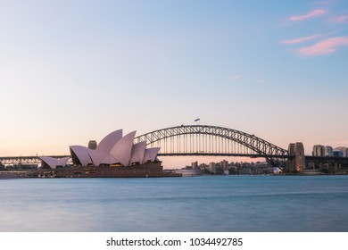 SYDNEY, AUSTRALIA - JANUARY 20, 2018: Sydney Opera House and Harbour Bridge view at dusk with clear sky.